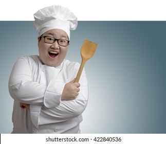 happy Asian chef with space on the right side