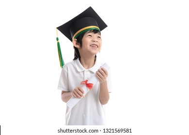 Happy Asian child in graduation gowns holding a Certificate on white background isolated.Graduation concept
