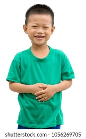 Happy Asian child smiling and holding his stomach. Portrait of young boy showing body parts isolated on white background.
