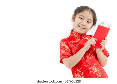 Happy Asian Chinese child receiving monetary gift or red paper packet on isolated background