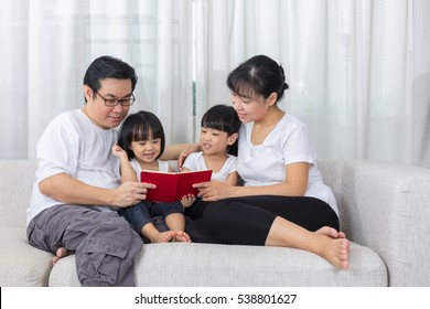 Family reading together images stock photos vectors shutterstock happy asian chinese family reading book on the couch in the living room at home sciox Gallery