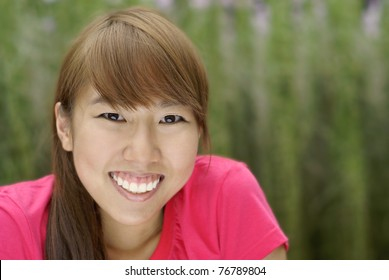 Happy asian chinese teen girl smile outdoors