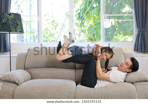 Happy Asian Dad Throws His Daughter Stock Image Download Now