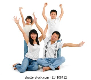 Happy Asian family arms up over white background