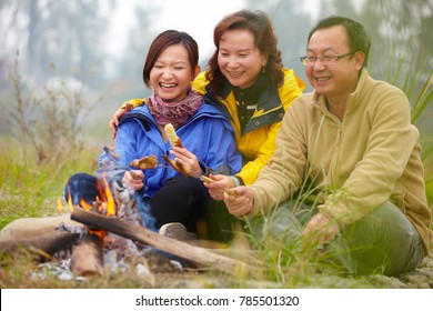 happy asian family camping roast outdoor