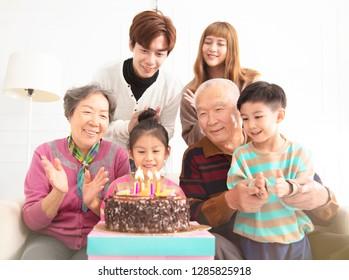 happy asian Family celebrating child's birthday