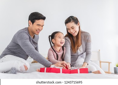 Happy Asian family with Christmas gift box, Asian Christmas and happy new year concept