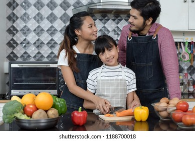 Happy Asian family are cooking in the kitchen at home.