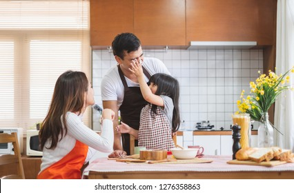 Happy Asian family cooking in kitchen, with happy and smile, lifestyle happy family concept