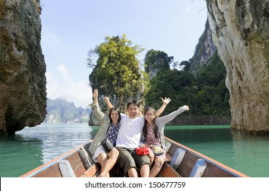 Happy Asian family enjoy a cruise on a holiday adventure by boat trip, Tourist fun the nature lake and island in summer, People lifestyle tourism in vacation travel Asia at Khao Sok Guilin of Thailand