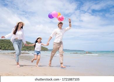 happy asian family enjoy summer vacation on the pattaya beach