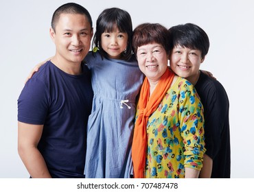 Happy Asian family. father, mother, daughter and grandmother, isolated on white background