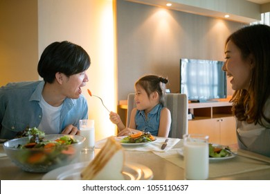 happy asian family have breakfast together