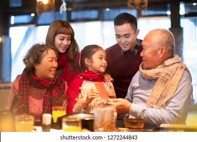 happy asian family having dinner and celebrating chinese new year