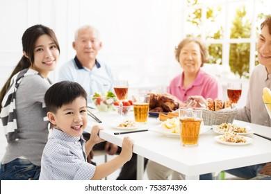 happy asian family having dinnerat home