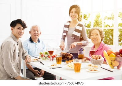 happy asian family having dinner at home