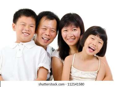 Happy Asian family laughing isolated on white background