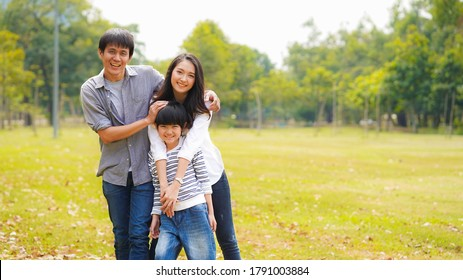 Happy Asian family lifestyle father mother and son spend time and do activity together with love and care in the park on holiday as happy family and good relationship