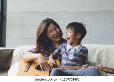 happy asian family at living room,happiness time of family playing at home,Mom and baby are happiness coexistence,happy family concept and Creating activities to strengthen skills for children.