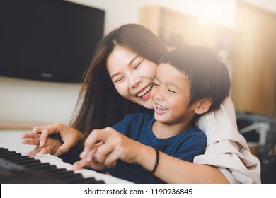 happy asian family at living room,happiness time of family playing at home,dad Mom and baby are happiness coexistence,happy family concept and Creating activities to strengthen skills for children.