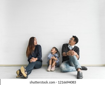 Happy asian family looking up. copy space.