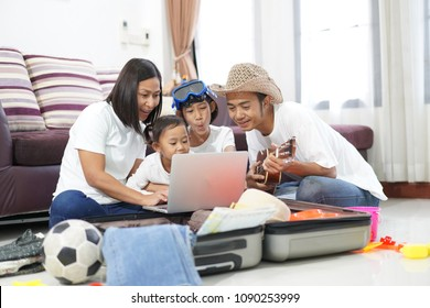Happy asian family on a floor at home planning vacation travel trip togetherness relaxation concept