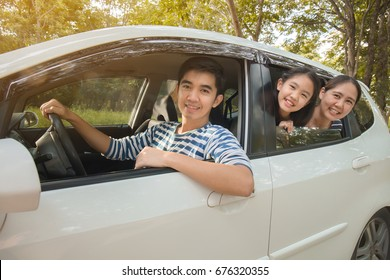 Happy Asian family on mini van are smiling and driving for travel in summer, Vintage filter