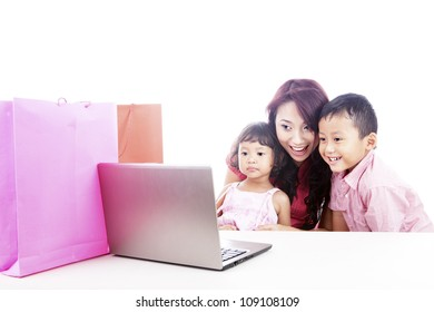 Happy asian family shopping online by using laptop computer, isolated on white