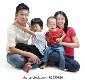 Happy Asian family sitting on white background