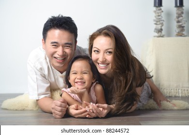 Happy Asian Family Smiling