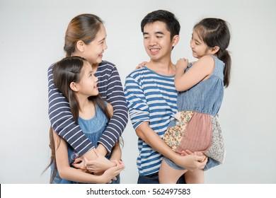Happy Asian family smiling on isolated background, Happy family enjoying together