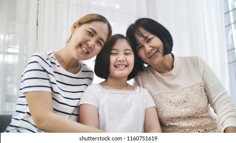 Happy Asian family smiling together at home, Multi generation of female