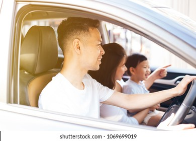 Happy Asian family is smiling and travelling on the road trip, going for a drive for vacation