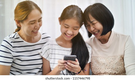 Happy Asian family take selfie photo shot together by smartphone, Multi generation of Asian female