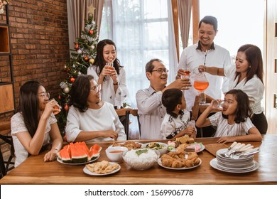 happy asian family tradition having lunch together on christmas day at home