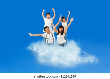 Happy Asian family traveling on cloud over blue sky