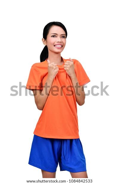 Happy asian female footballer celebrating her goal isolated over white background