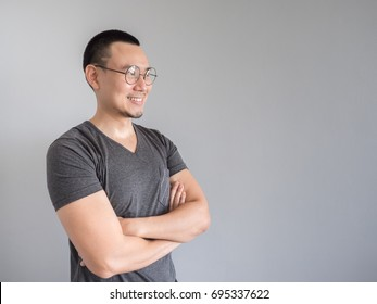 Happy Asian freelance man with skinhead and relaxing mile haircut.