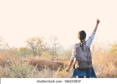 Happy Asian girl backpack  in nature background, Relax time on holiday concept travel ,color of vintage tone and soft focus