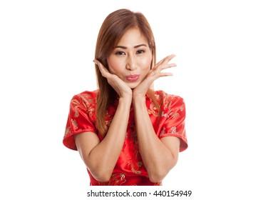 Happy Asian girl in chinese cheongsam dress on gray background