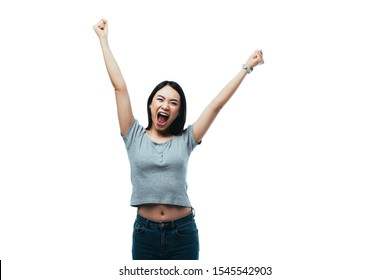 happy asian girl showing yeah gesture with open mouth isolated on white