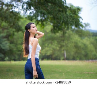 Happy Asian girl smiling beautiful looking at camera.Portrait of young beautiful cute cheerful girl smiling looking at camera
