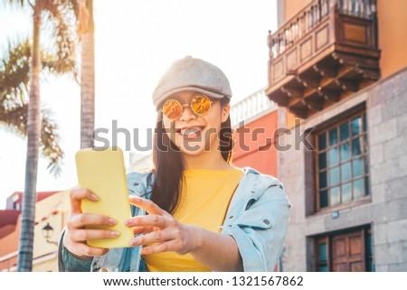 Happy Asian girl using