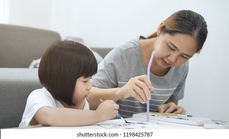 Happy Asian girl and woman together drawing and painting, Happiness moment at home