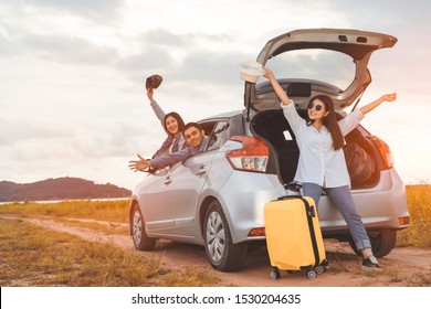 Happy asian group of friends car travel driving and suitcase at mountain lake river in vacation summer road trip on holidays to destination, Traveler transportation vehicle people lifestyle