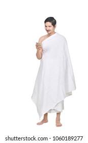 Happy asian hajj pilgrim using mobile phone isolated over white background