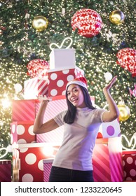 happy asian lady love christmas and new year festival with christmas tree and light decoration in new year festival.