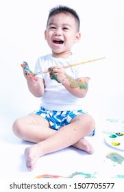 Happy asian little baby childhood playing use paintbrush draw watercolor or fingerpaint on hand by oneself, Baby 2-3 years