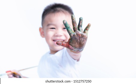 Happy asian little baby childhood show he hand and have colorfull on hand, this is fingerpaint he draw color by oneself, Baby 2-3 years