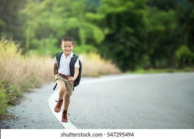 Happy Asian little boy go to school